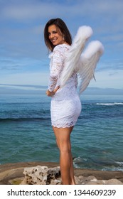 beautiful woman with wings by the ocean