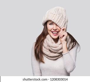 Beautiful woman winter portrait. Smiling girl wearing warm clothes having fun