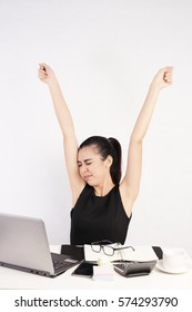 Beautiful Woman Woking at Desk, Stretching and raising her arms, Working Concept