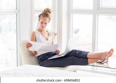 Beautiful Woman Working With Documents on Loggia