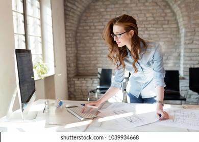 Beautiful woman working in modern office