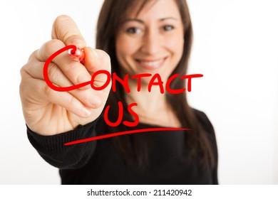 "Beautiful woman writing ""Contact us"" on the screen"