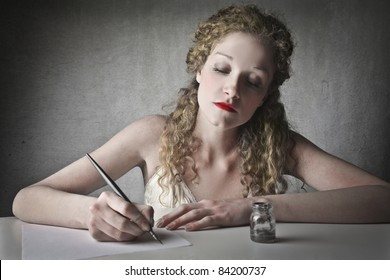 Beautiful woman writing a letter