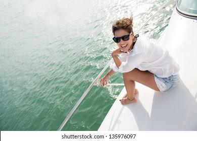 Beautiful woman in a yacht enjoying the summer