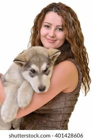 Beautiful woman with young dog Malamute