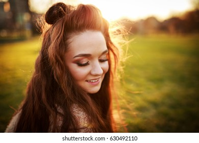 Beautiful woman. Young woman outdoors portrait. Soft sunny colors.