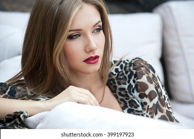 Beautiful woman. Young pretty woman with beautiful long hairs and red lips