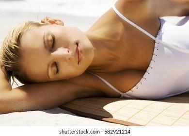 Beautiful woman's body in sexy bikini over beach