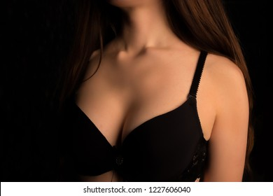 Beautiful woman's breasts in bra