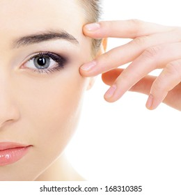 beautiful woman's face with accent on eyes, eye scanning technology, health care