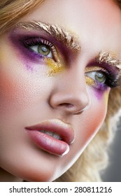 Beautiful woman's face with gorgeous make-up close-up