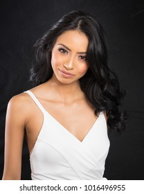 Beautiful woman's face and hair wearing white dress