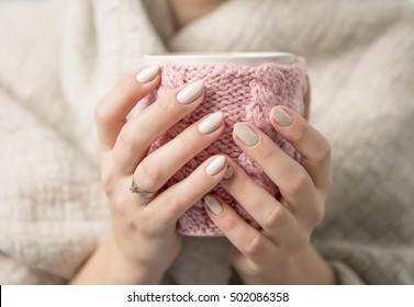 beautiful woman's hands with a cup