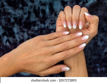 Beautiful woman's nails with beautiful french manicure ombre peach and white