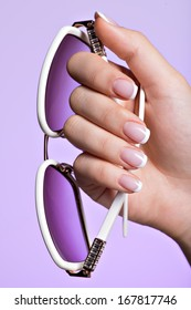 Beautiful woman's nails with beautiful french white manicure