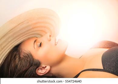 Beautiful womansunbathing in black bikinis