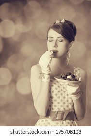 Beautiful women with candy. Photo in retro style with bokeh at background.