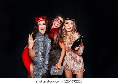 Beautiful Women Celebrating New Year, Having Fun At Party. Portrait Of Happy Smiling Girls In Stylish Glamorous Dresses With Champagne At Birthday Party.