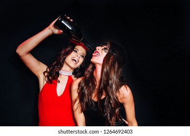Beautiful Women Celebrating New Year. Portrait Of Happy Smiling Girls In Stylish Glamorous Dresses With Champagne At Birthday Party.