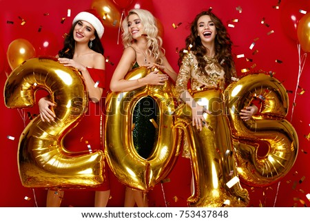 47fcf1cdb5f Beautiful Women Celebrating New Year. Happy Gorgeous Girls In Stylish Sexy  Party Dresses Holding Gold