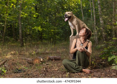 Beautiful women and dog in forest summer time