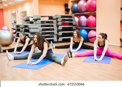 Beautiful women doing fitness or pilates exercise and stretching.