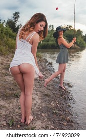 Beautiful women fishing at a river with the hook caught in a dress and pulling up the dress