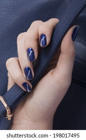 beautiful women hand with blue manicure