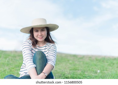 Beautiful women are happy to take pictures which has bright sky are background.