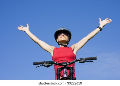 Beautiful women with her arms outstretched isolated on blue sky