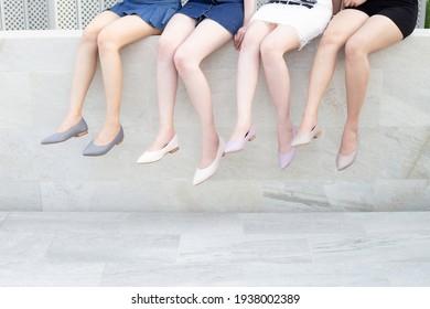 Beautiful women leg wearing shoes, hanging legs together.
