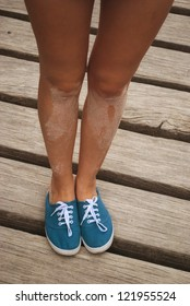 The beautiful women legs on the wood floor