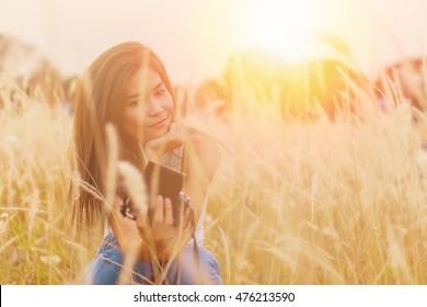 beautiful women outdoors enjoying nature.warm tone.