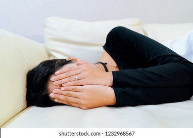 Beautiful women posing - hides her faces in her hands and depressed