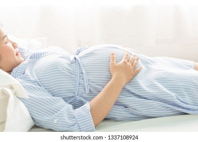 Beautiful women pregnant on bed