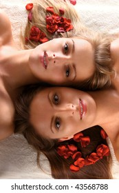 Beautiful women with red flower petals