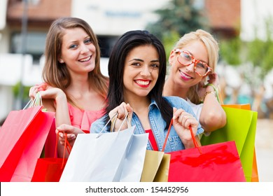 Beautiful women with shopping bags in the city for a shopping.