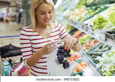 Beautiful women shopping vegetables and fruits in supermarket