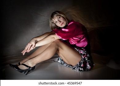 beautiful women sit on  the floor