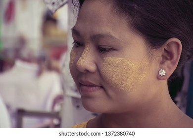 Beautiful women with traditional Tanaka on face.