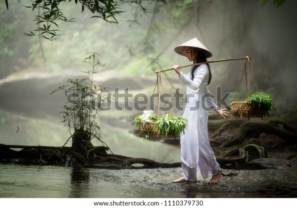 Beautiful women with traditional Vietnamese culture Ao dai is a traditional costume famous Ho Chi Minh Vietnam wilderness walk