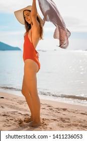 Beautiful women  walking on the beach in summer Thailand