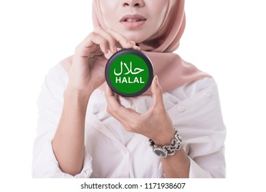 Beautiful women wearing hijab holding halal. Halal certification concept. Sign of halal food.