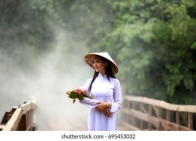 Beautiful women wearing white ao dai traditional Vietnamese dress