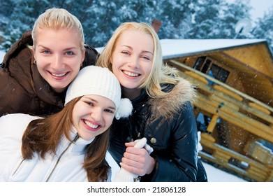 Beautiful women in winter clothing outdoors