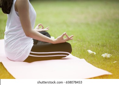 Beautiful women yoga in nature, hipster tone and selective focus