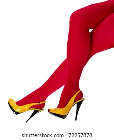 Beautiful women's feet in the yellow shoes and a crimson tights