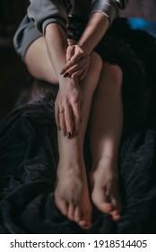 beautiful women's legs on a dark background