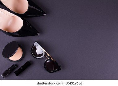 beautiful women's minimal set of fashion accessories on black background. Good for blogs or magazines, pinterest or instagram. Free space for text.