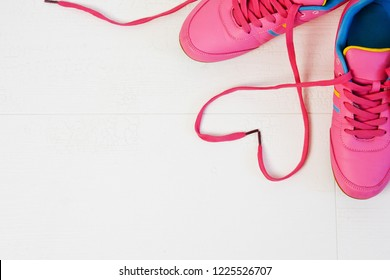 Beautiful women's sports sneakers with heart-shaped laces